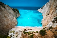 Shipwreck in Navagio beach. Azure turquoise sea water and paradise sandy beach. Famous tourist visiting landmark on. Zakynthos island, Greece royalty free stock photos
