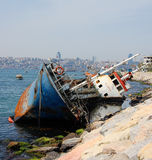 Shipwreck near city Stock Images