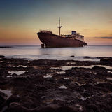 Shipwreck in the ocean stock images