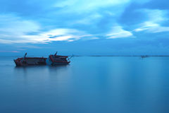 Shipwreck in the ocean on twilight Royalty Free Stock Photo
