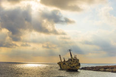 A shipwreck on the rocks. A ship which ran aground in Cyprus in stormy seas few years ago is still stranded on the rocks Royalty Free Stock Photos