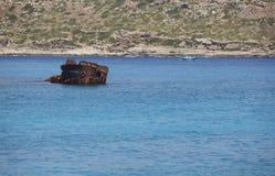 Shipwreck and sailboat at Imeri Gramvousa Bay. Crete. Greece Stock Photos