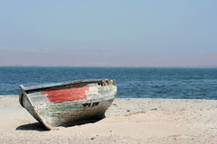 Shipwreck on the sand Royalty Free Stock Photos