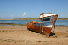 Shipwreck on a sandy seashore Royalty Free Stock Photo