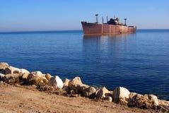 Shipwreck on seashore stock photos