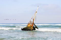 Shipwreck in the Shallow Waves Royalty Free Stock Photo