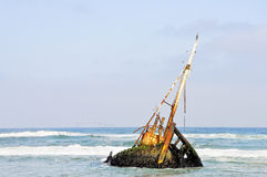 Shipwreck in the Shallow Waves Royalty Free Stock Photos