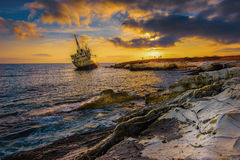 A Shipwreck by the shores of the Mediterranean sea in Cyprus at sunset Royalty Free Stock Images