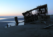 Shipwreck Silhouette 2. The Peter Iredale, an historic shipwreck at Fort Stevens State Park on the Oregon coast. Silhouetted against an evening sky at low tide Stock Images