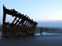 Shipwreck Silhouette 4. The Peter Iredale, an historic shipwreck at Forst Stevens State Park on the Oregon coast. Silhouetted against an evening sky at low tide Stock Photography