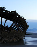 Shipwreck Silhouette 5. The Peter Iredale, an historic shipwreck at Forst Stevens State Park on the Oregon coast. Silhouetted against an evening sky at low tide Royalty Free Stock Images