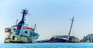 Shipwreck. Sinking ship in the middle of the sea Stock Photography