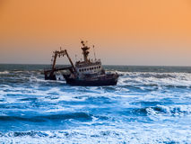 Shipwreck on Skeleton Coast in Namibia. Shipwreck on Skeleton Coast of Atlantic Ocean in Namibia stock photography