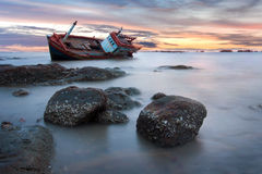 Shipwreck. Stranded on the beach at sunset Royalty Free Stock Photography