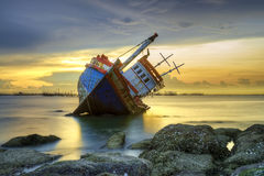 Shipwreck at sunset stock photography