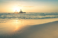 Shipwreck at sunset on the namibian Skeleton Coast Stock Photo