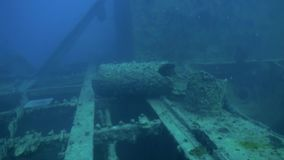 Shipwreck underwater in Red Sea Egypt. Ghost ship background of fish in the blue lagoon on coral reef. Extreme tourism.Deep diving stock video footage
