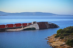 Shipwreck. View of an old rusty Shipwreck in a calm bay Royalty Free Stock Photography