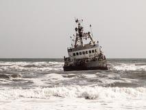 Shipwreck in wild Atlantic Ocean at Skeleton Coast, Namibia, Africa.  stock images