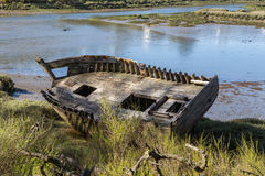 Shipwreck of wooden boat washed ashore royalty free stock photo