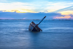 Shipwreck or wrecked boat Stock Images