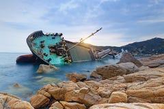 Shipwreck or wrecked cargo ship abandoned Stock Photos
