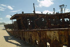 Shipwrecked on the beach Royalty Free Stock Photo