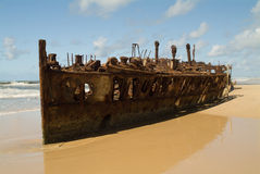 Shipwrecked on the beach Stock Photography