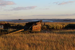 Shipwrecked boat. Boat shipreck metal grass sky Royalty Free Stock Photos