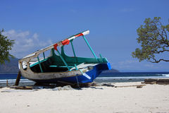 Shipwrecked old boat. Gili Trawangan white sandy beaches and blue sky - shipwrecked old boat Royalty Free Stock Photo