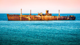 Shipwrecked rusted cargo ship Royalty Free Stock Photo
