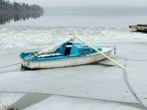 Shipwrecked. Sail boat Jammed in ice Stock Image