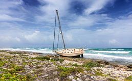 Shipwrecked sailing boat. On the caribbean coast Royalty Free Stock Photography