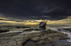 Shipwrecked. Ship crash the rock in the sea Stock Images