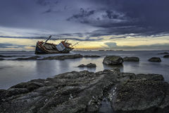 Shipwrecked. Ship crash the rock in the sea Royalty Free Stock Image