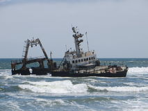 Shipwrecked. A shipwreck on the skeleton coast of Namibia Royalty Free Stock Photography