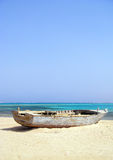 Shipwrecked Wooden Boat on Beach Royalty Free Stock Images