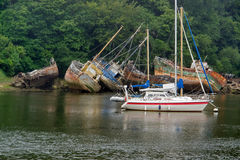 Shipwrecks. And boat on a river in Brittany, France Stock Photos
