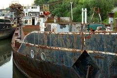 Shipwrecks. Old rusty shipwrecks on a river Stock Photo