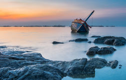 Shipwrecks. Shipwreck in the sea with sunset Stock Images