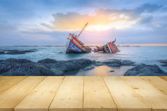 Shipwrecks and sunset. Ancient shipwrecks in the sea with sunset background Stock Images