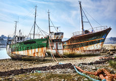 Shipwrecks. Wrecks of wooden ships anchored on an empty shore at the Atlantic Ocean Royalty Free Stock Image