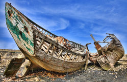 Shipwrecks. Wrecks of wooden ships on an empty shore at the Atlantic Ocean Royalty Free Stock Image
