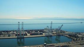Shipyard Aerial. V23 Flying low over large commercial shipyard panning stock video