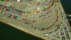 Shipyard Aerial. V8 Flying low vertical shot looking down over large commercial shipyard and ships stock video footage