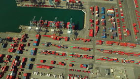 Shipyard Aerial. V11 Flying vertical shot looking down over large commercial shipyard and ships stock video