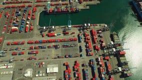 Shipyard Aerial. V12 Flying vertical shot looking down over large commercial shipyard and ships