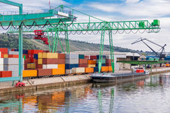 Shipyard with containers and cranes Stock Image