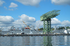 Shipyard crane. Bremerton, WA, USA Sept 4, 2016: Massive green crane at Pier 6  Puget Sound Naval Shipyard and Intermediate Maintenance Facility Royalty Free Stock Photo