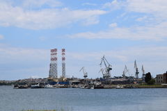 A shipyard with cranes in the background. Royalty Free Stock Photos